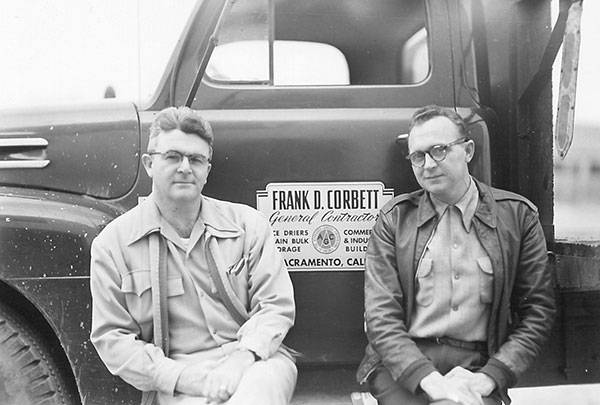 Frank D. Corbett.  General Contractor and founder of Television Education, Inc. sitting in front of his work truck.